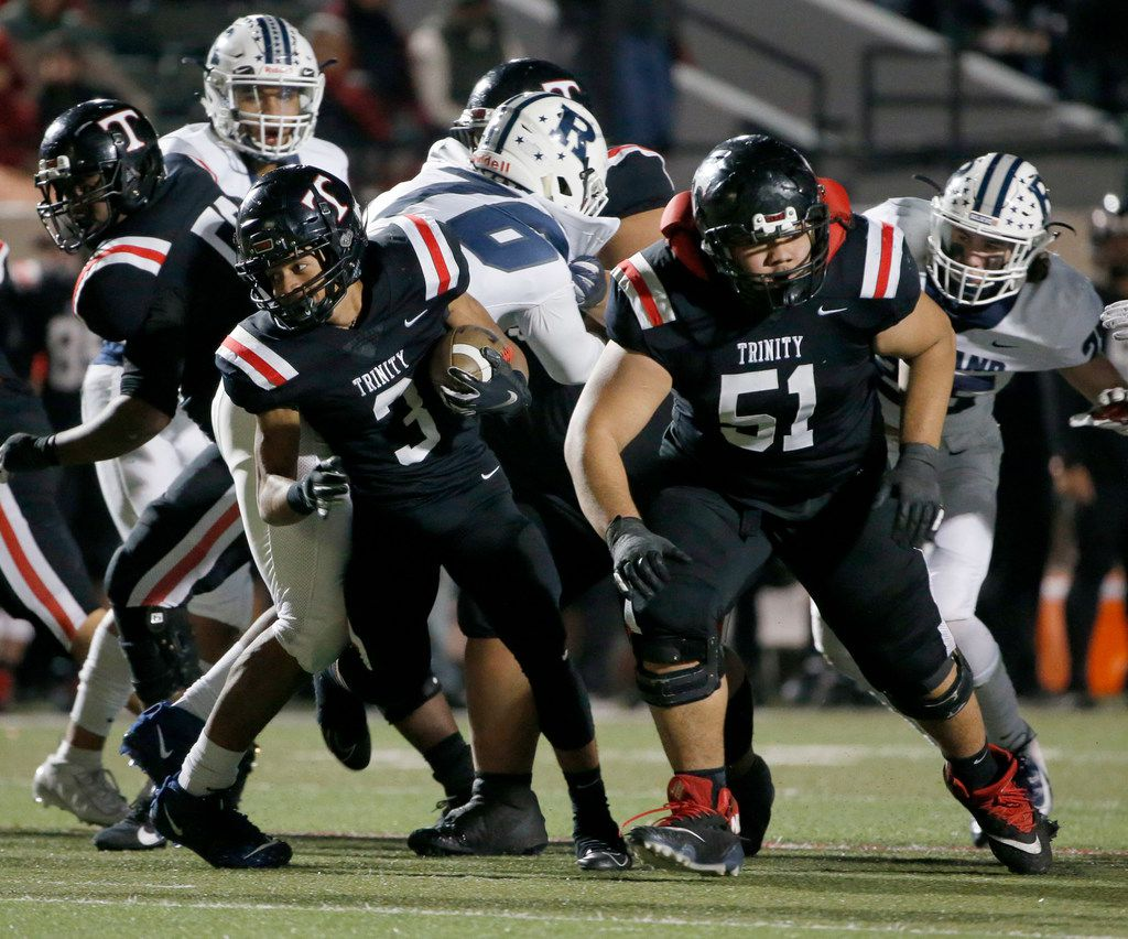 Euless Trinity's Lotu Asaeli (51) blocks for Zechariah Moore (3) as they played Richland during the first half of their high school football game on Friday Nov. 8, 2019. (Michael Ainsworth/Special Contributor)