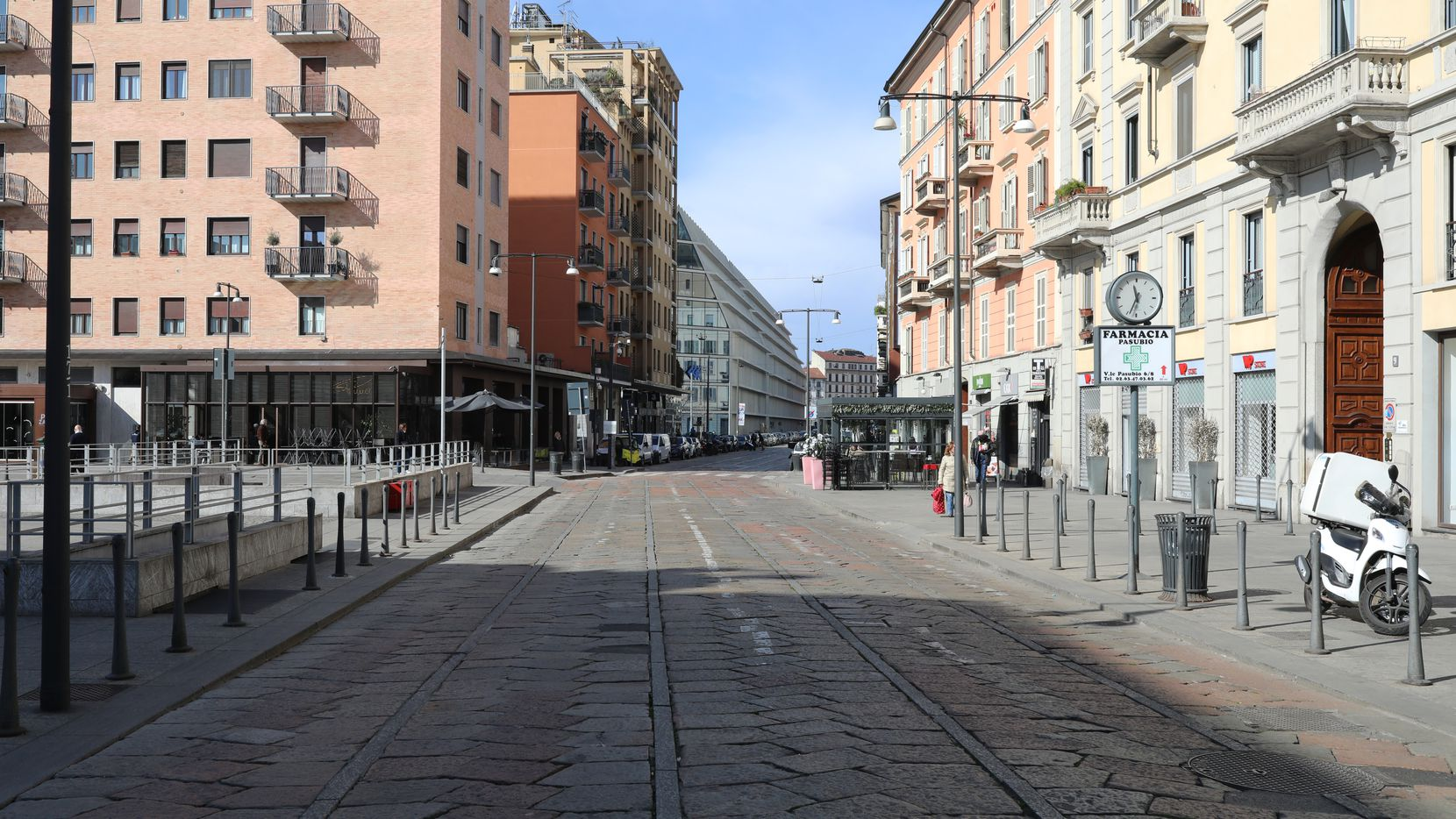 MILAN, ITALY - FEBRUARY 26: A main road in the city center is seen empty on February 26, 2020 in Milan, Italy. 
