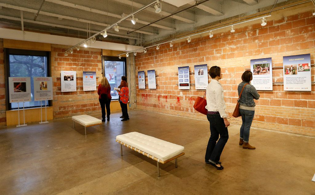 Visitors took in information at the exhibit on its opening day Friday. (Jae S. Lee/Staff Photographer)