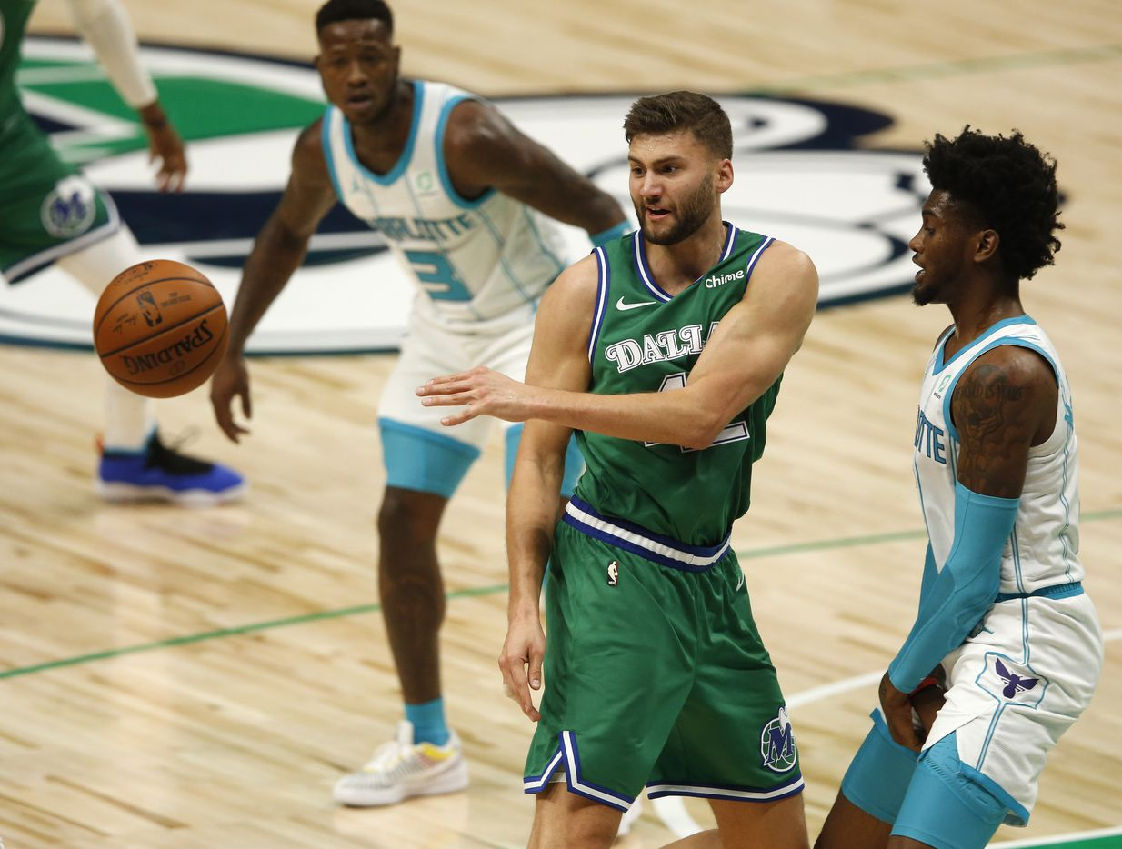 Dallas Mavericks forward Maxi Kleber (42) passes the ball out as Charlotte Hornets forward Jalen McDaniels (6) defends during the second quarter of play in the home opener at American Airlines Center on Wednesday, December 30, 2020 in Dallas. (Vernon Bryant/The Dallas Morning News)