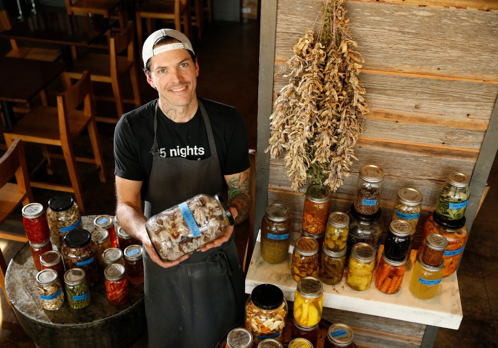"""Chef Matt McCallister has taken his five-star Design District restaurant, FT33, 100 percent local, and as a result, he is preserving produce, meats and fish in a variety of ways. He displays some of his projects in the restaurant's dining room, where he says they'll soon be featured on a """"butcher's table."""""""