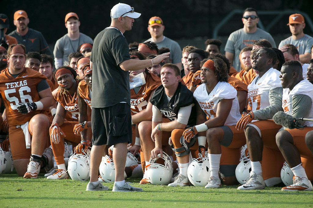 Texas first year head coach Tom Herman gathered the team together for some words early in practice during the Texas Longhorns training camp  in July.