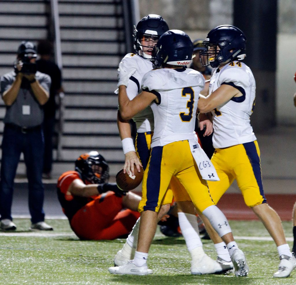 Highland Park quarterback Chandler Morris (4) in congratulated by teammates after scoring a touchdown, the first of a pair of late game touchdowns to seal the win, during the fourth quarter Highland Park's 66-59 win over Rockwall high school at Wilkerson-Sanders Stadium in Rockwall on Friday, August 30, 2019. (John F. Rhodes / Special Contributor)