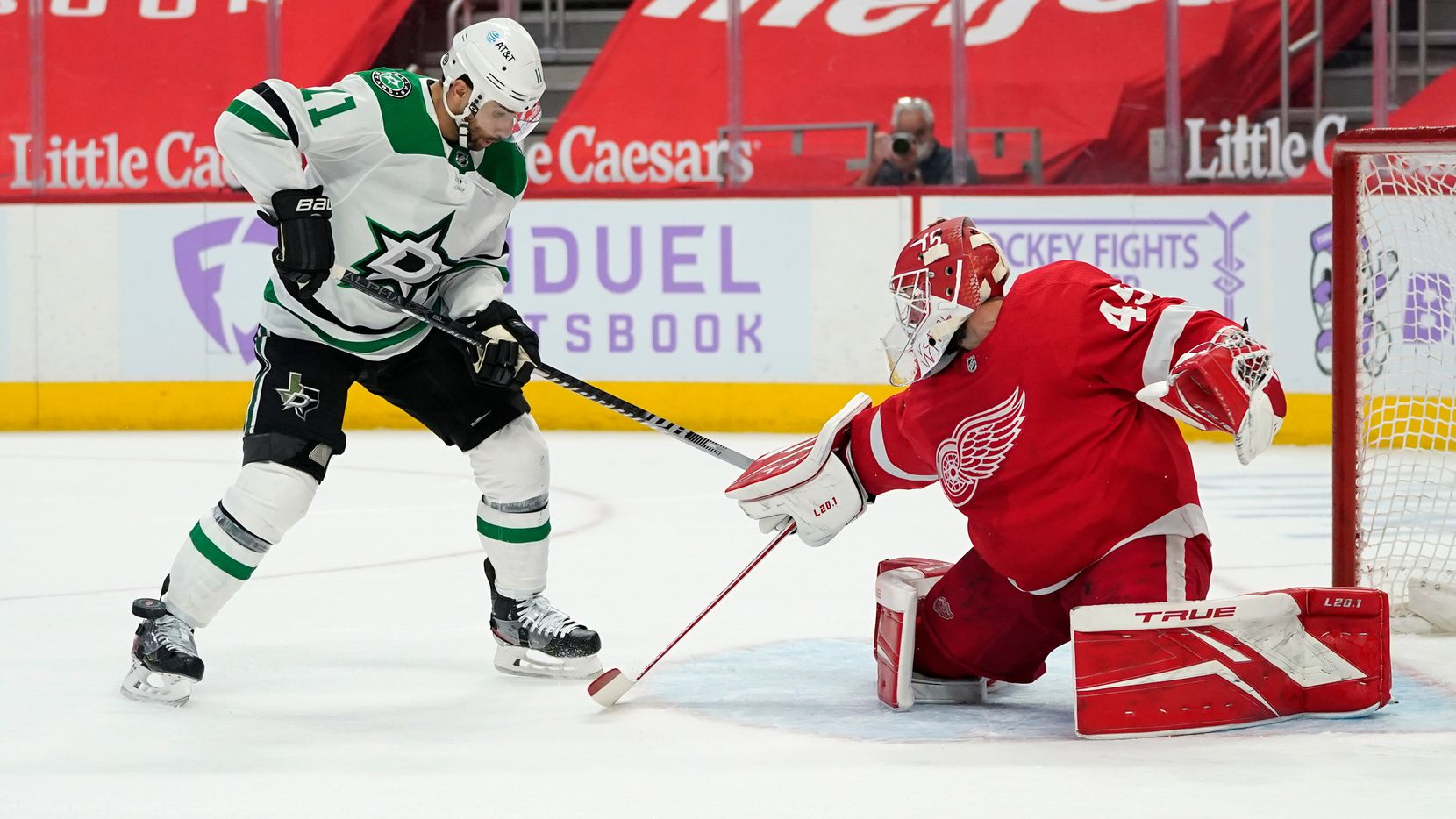 Detroit Red Wings goaltender Jonathan Bernier (45) stops a Dallas Stars center Andrew Cogliano (11) shot in the first period of an NHL hockey game Saturday, April 24, 2021, in Detroit. (AP Photo/Paul Sancya)