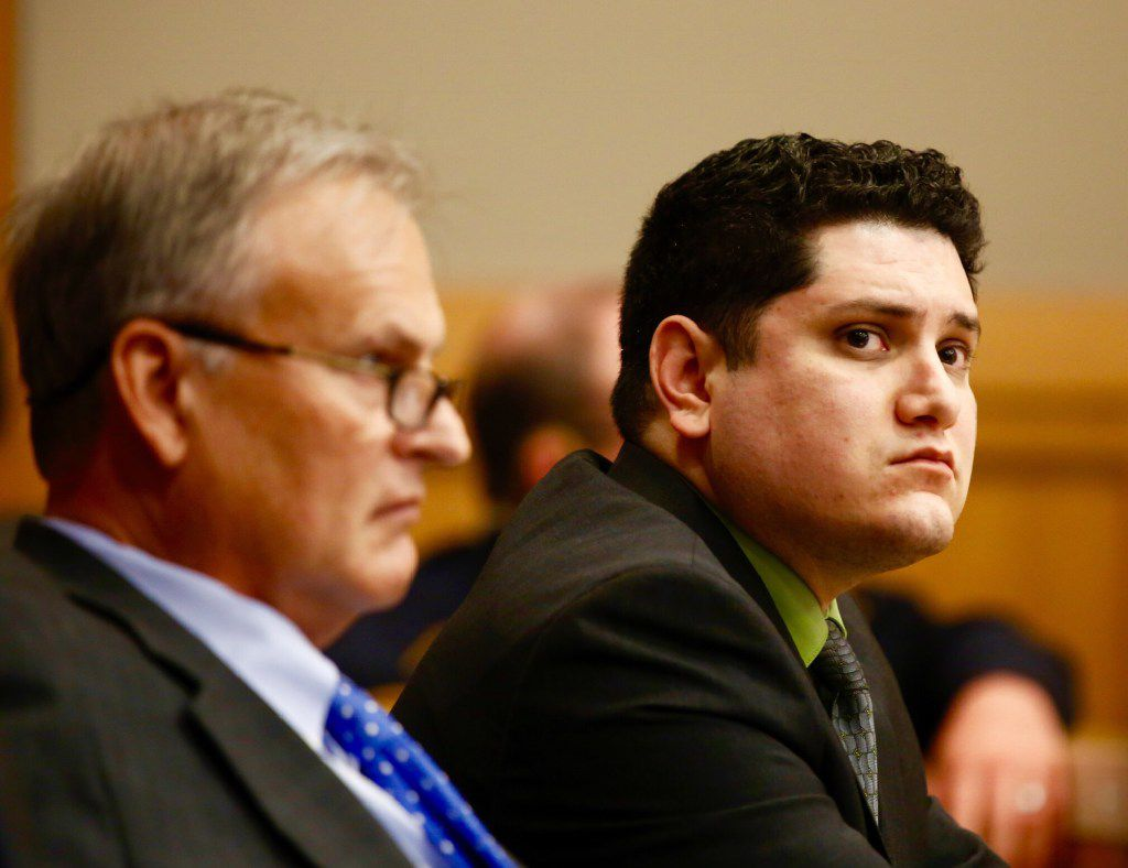 Enrique Arochi (right) sits with defense attorney Steven Miears during his trial in Collin County last September. (David Woo/Staff Photographer)