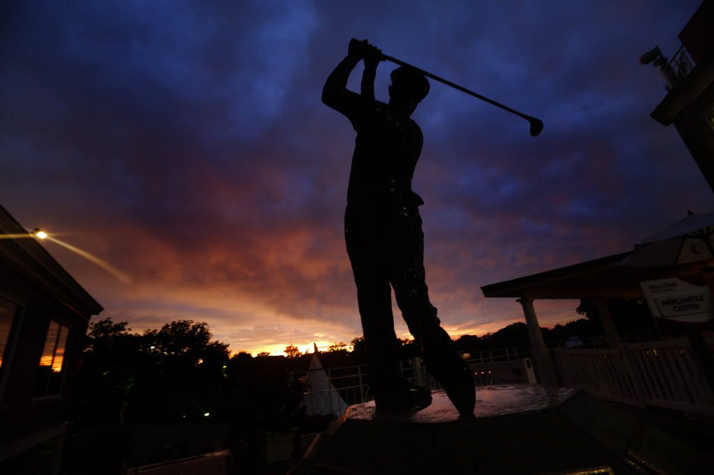 After the rain had passed, a colorful sunset occurred behind the Ben Hogan statue following the PGA Crowne Plaza Invitational at Colonial Country Club in Fort Worth, Sunday, May 25, 2014. (Tom Fox/The Dallas Morning News)
