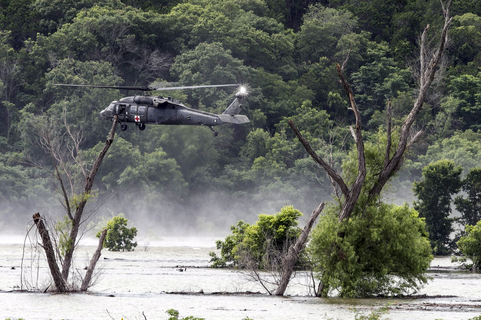 An Army helicopter hovered above Lake Belton on June 3, 2016, during the search for missing soldiers from Fort Hood. They were swept away as their truck went through a low-water crossing during training.