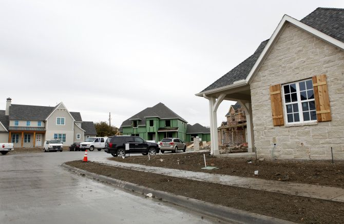 Houses are under construction in a small neighborhood on Spring Branch Drive in Dallas' Lake Highlands area.