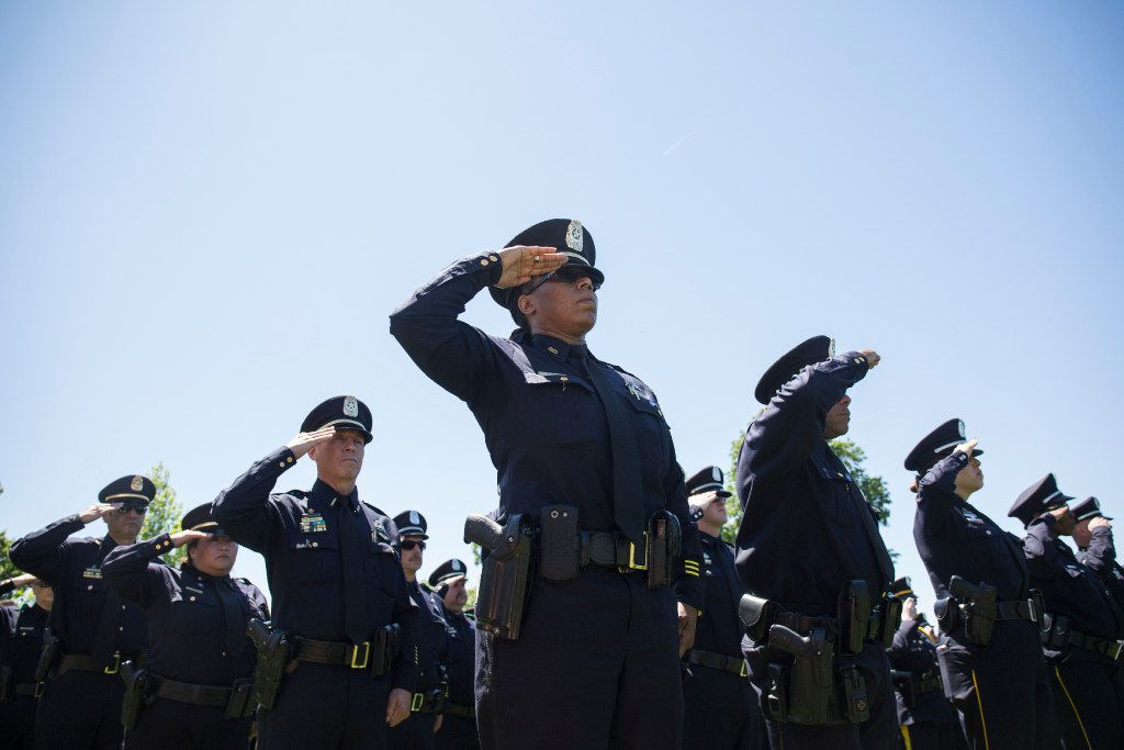 Texas law enforcement officers saluted as names of Texans are read during a roll call of fallen officers during the 36th Annual National Peace Officers' Memorial Service on the West Lawn of The U.S. Capitol Building in May 2017. The service, which takes place every year on May 15, honored federal, state, and local officers killed or disabled in the line of duty.