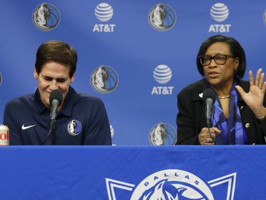 Dallas Mavericks interim CEO Cynthia Marshall addresses the room next to Dallas Mavericks owner Mark Cuban  during a press conference at American Airlines Center in Dallas on Monday, February 26, 2018. Marshall has been hired by the Mavericks to help clean up after the recent sexual harassment scandal in the front office. (Vernon Bryant/The Dallas Morning News)