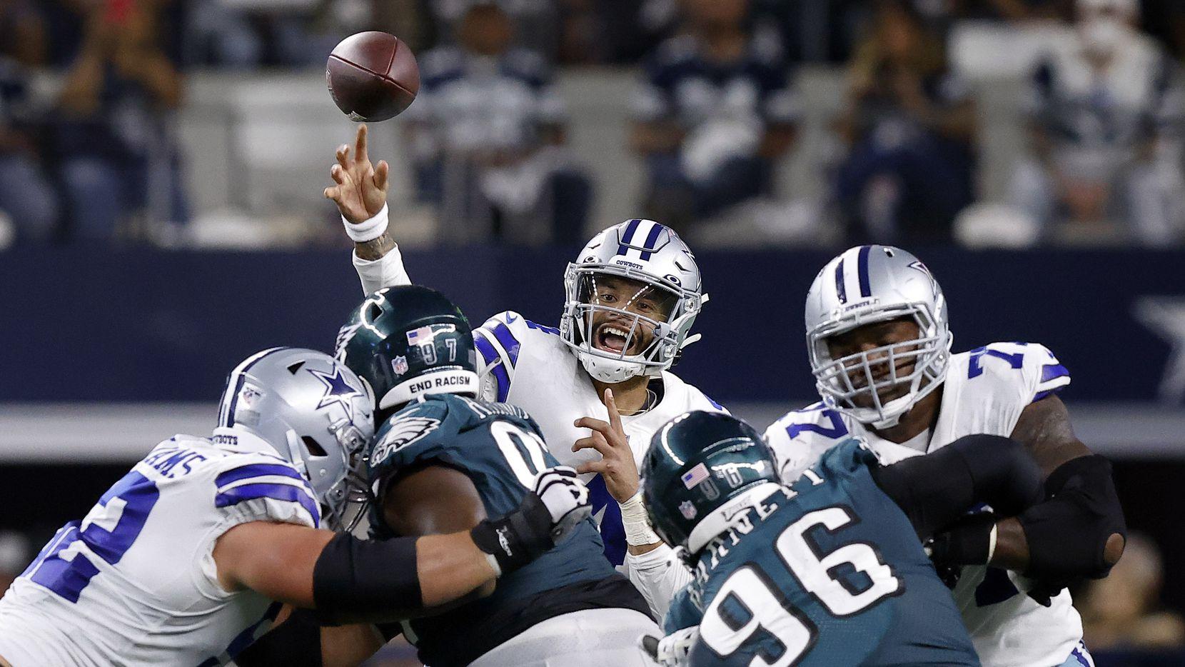Dallas Cowboys quarterback Dak Prescott (4) releases a pass over the Philadelphia Eagles defensive line during the second quarter at AT&T Stadium in Arlington, Monday, September 27, 2021.