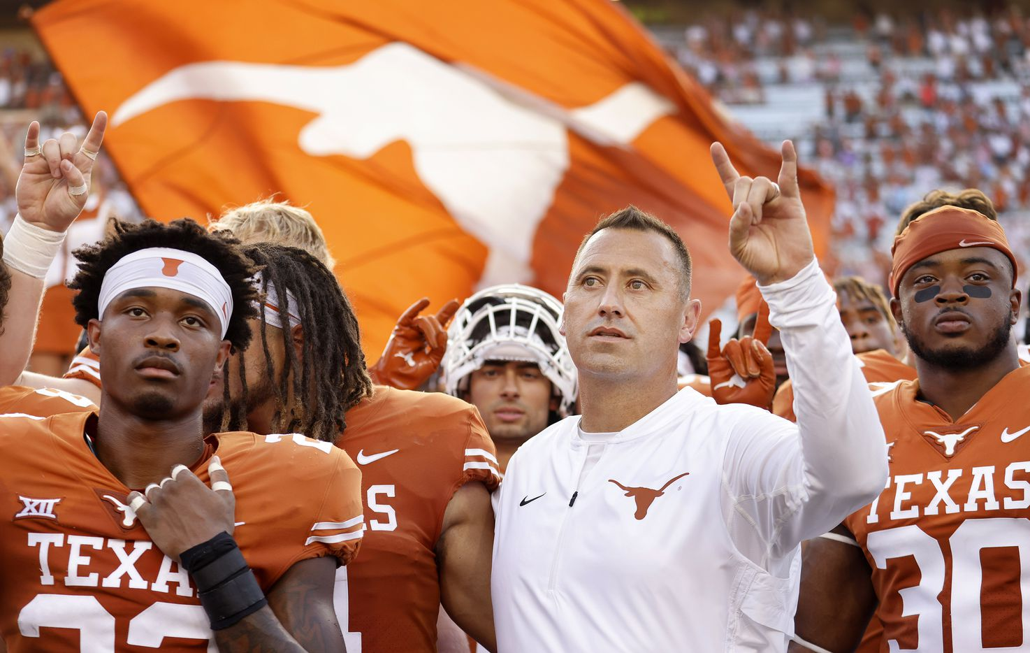 Texas Longhorns head coach Steve Sarkisian (center) and his players sing 'The Eyes of Texas' following their win over the Louisiana-Lafayette Ragin Cajuns at DKR-Texas Memorial Stadium in Austin, Saturday, September 4, 2021. (Tom Fox/The Dallas Morning News)