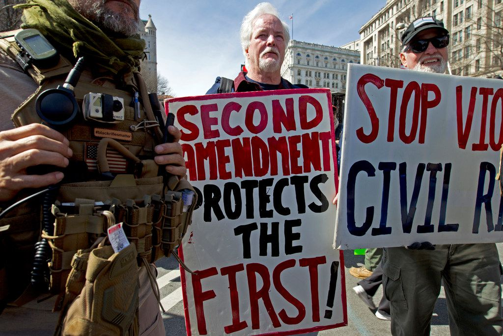 "Pro-gun demonstrators protest during the ""March for Our Lives"" rally in support of gun control in Washington on Pennsylvania Avenue near the U.S. Capitol."