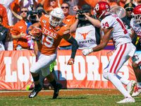 Texas defensive back Brandon Jones (19) returns an interception during the first half of an NCAA football game against Oklahoma at the Cotton Bowl on Saturday, Oct. 12, 2019, in Dallas.