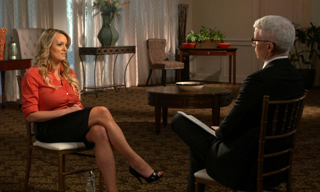"""This image released by CBS News shows Stormy Daniels, left, during an interview with Anderson Cooper which will air on Sunday on """"60 Minutes."""" (CBS News/60 Minutes via AP)"""
