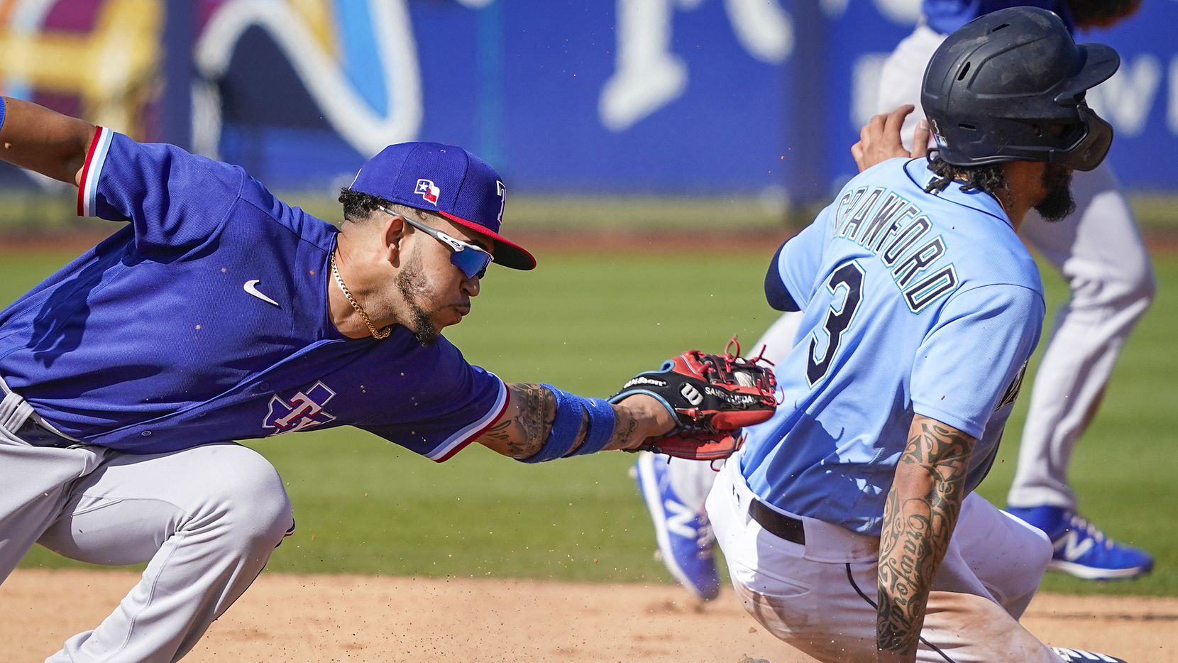 Rangers infielder Anderson Tejeda can't make the tag as Seattle Mariners shortstop J.P. Crawford steals second base during the fifth inning of a spring training game at Peoria Sports Complex on Sunday, Feb. 23, 2020, in Peoria, Ariz.