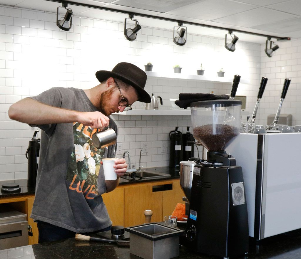 Beau Maddox pours steam milk to make a cup of Latte at Hands + Rose Coffee, located inside of Upper Room Dallas on Tuesday, September 26, 2017. (David Woo/The Dallas Morning News)