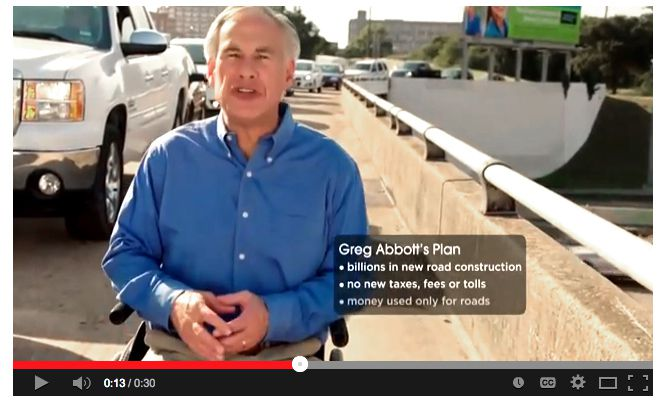 """In his latest ad, Greg Abbott appears on a bridge skirting a highway and says: """"A guy in a wheelchair can move faster than traffic on some roads in Texas."""""""