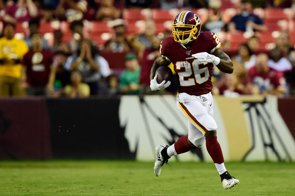 LANDOVER, MD - AUGUST 15: Adrian Peterson #26 of the Washington Redskins rushes with the ball in the first quarter against the Cincinnati Bengals during a preseason game at FedExField on August 15, 2019 in Landover, Maryland.