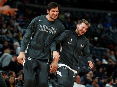 Mavericks center Boban Marjanovic (left) jokes with guard Luka Doncic as they warm up before facing the Nuggets on Tuesday, Oct. 29, 2019, in Denver.