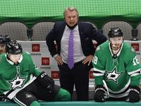Dallas Stars head coach Rick Bowness is angry with referee Dave Lewis (46) for a late third period interference call against Andrej Sekera at the American Airlines Center in Dallas, Thursday, March 4, 2021. The Stars fell to the Columbus Blue Jackets, 3-2.