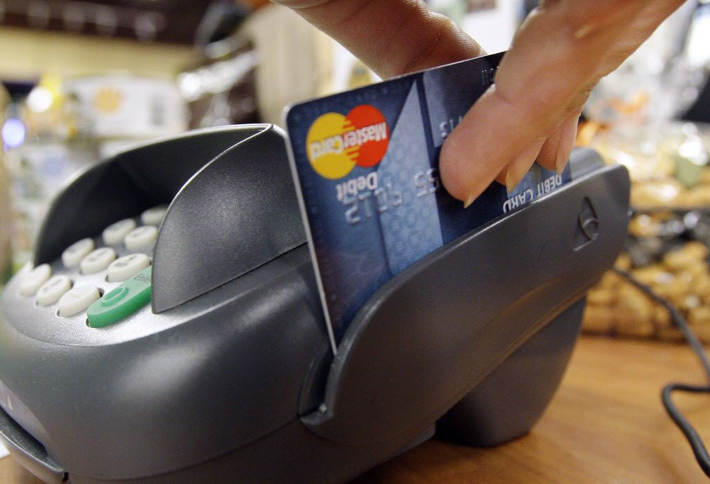 For years in Texas, it's been illegal for Texas merchants to charge extra when consumers pay with a debit or credit card. Because of U.S. Supreme Court action, that law was overturned. Now merchants can charge up to 4 percent extra when you pay with a credit card. (File photo/The Associated Press)