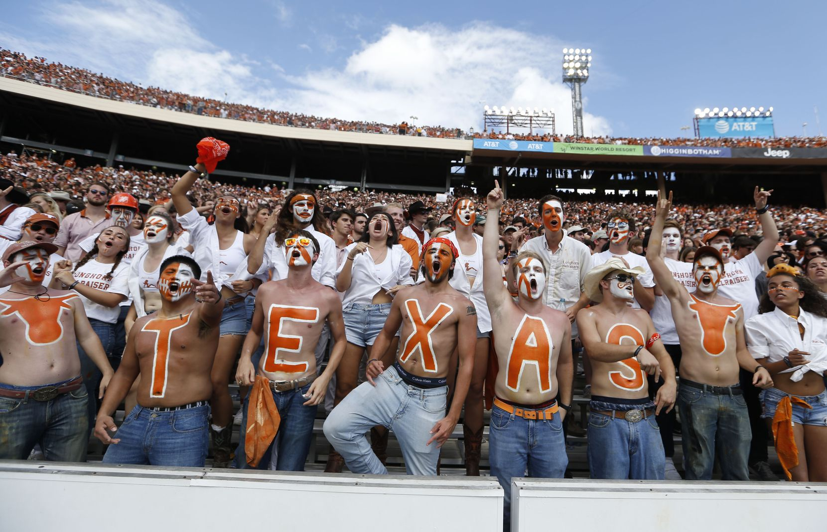 Texas Longhorns fans cheer for their team during the second half of play at the Cotton Bowl in Dallas on Saturday, October 6, 2018.