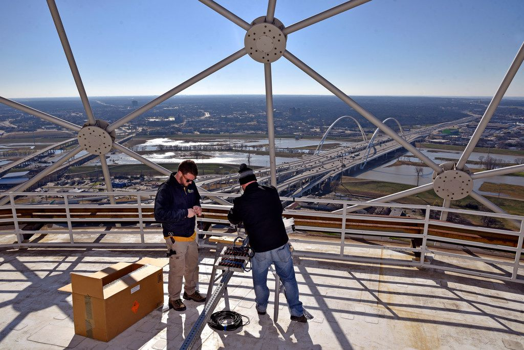 Pyrotechnicians Nick Pravecek, left, and Nick Barnes, of Melrose Pyrotechnics, stand on a Reunion Tower roof as they install fireworks for this year's New Years Eve celebration, Dec. 28, 2018. The Chicago based company has been working the New Years Eve show for the past five years.