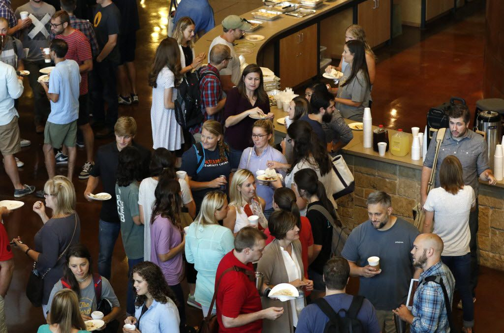 Watermark Community Church employees visit over coffee.
