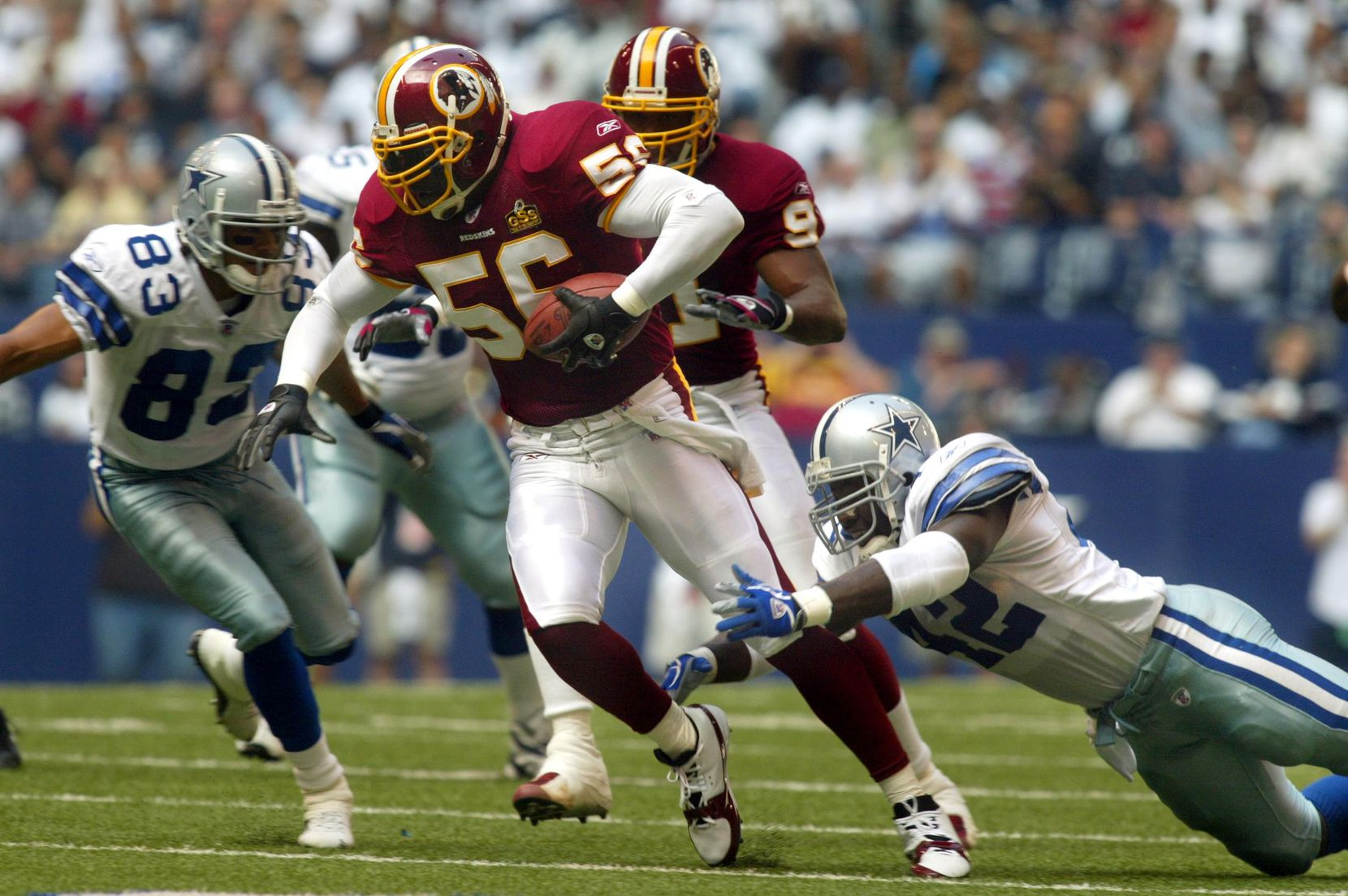 11/2/03: Cowboys running back Troy Hambrick (42) tries make the tackle after giving up a fumble to Redskins LaVar Arrington (56) who returned it deep into Dallas territory.  The Cowboys defeated the Redskins 21-14 at Texas Stadium.