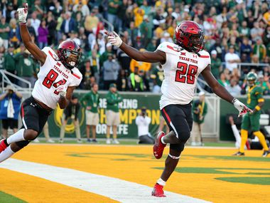 WACO, TEXAS - OCTOBER 12: Erik Ezukanma #84 and SaRodorick Thompson #28 of the Texas Tech Red Raiders celebrate a fourth-quarter touchdown against the Baylor Bears on October 12, 2019 in Waco, Texas.