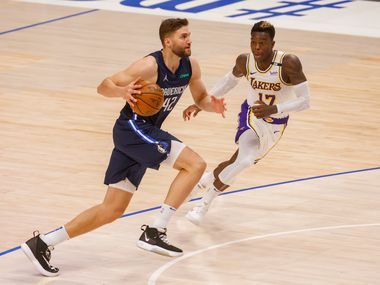 Dallas Mavericks forward Maxi Kleber (42) drives past Los Angeles Lakers guard Dennis Schroder (17) during the second half at the American Airlines Center on Saturday, April 24, 2021, in Dallas. Mavericks won, 108-93.