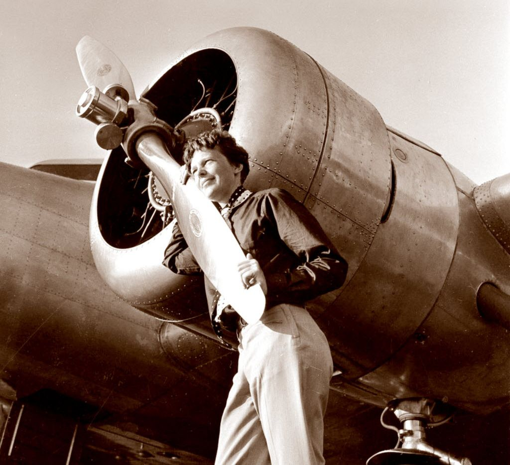 A May 20, 1937 photo, provided by the Paragon Agency, shows aviator Amelia Earhart with her Electra plane's propeller at Burbank Airport in Burbank, Calif.