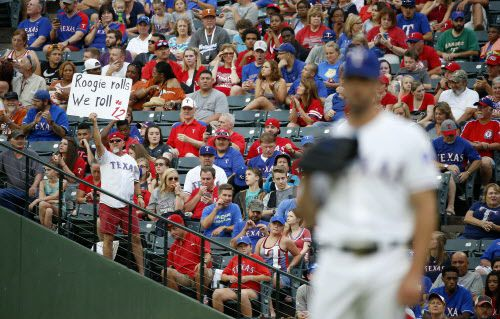 A fan holds up a sign supporting Rougned Odor during a recent game between the Texas Rangers and Kansas City Royals at Globe Life Park in Arlington. The Arlington City Council made it official in a special Tuesday meeting, giving final approval to an ordinance calling for an election to build a new stadium for the Rangers.