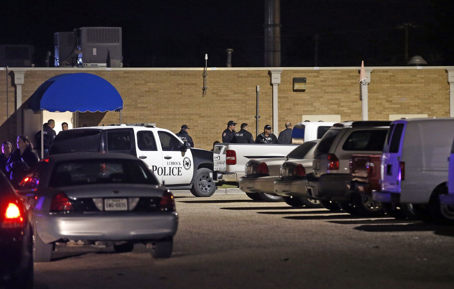 Police officers work the scene of a shooting at the Texas Tech Police Department.