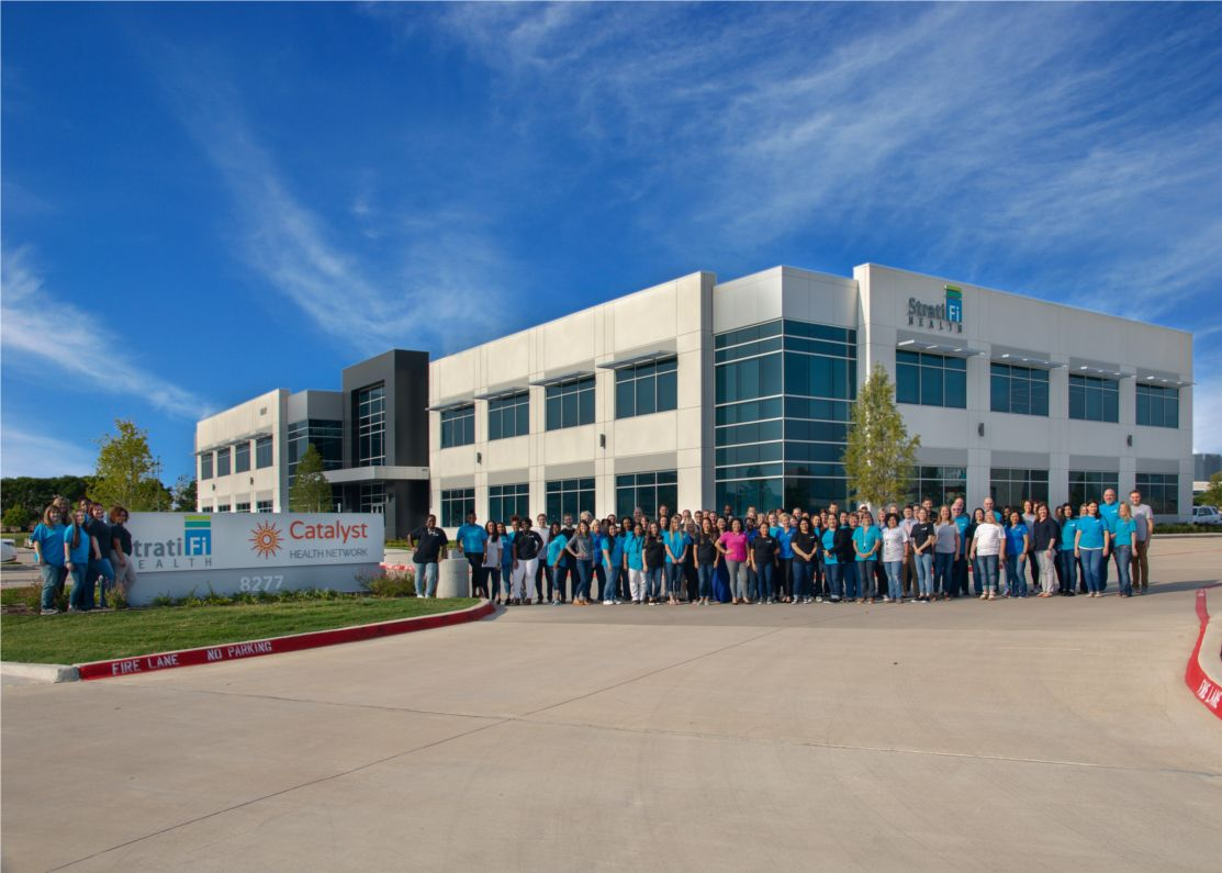 Catalyst Health workers pose for a group shot at its Plano office.