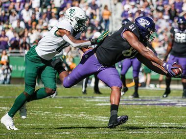 TCU Horned Frogs tight end Pro Wells (81) receives a pass as Baylor Bears cornerback Kalon Barnes (12) defends during the first half of an NCAA football matchup between the Texas Christian University Horned Frogs and the Baylor Bears at Amon G. Carter Stadium in Fort Worth, Texas, on Saturday, No. 9, 2019. (Ryan Michalesko/The Dallas Morning News)