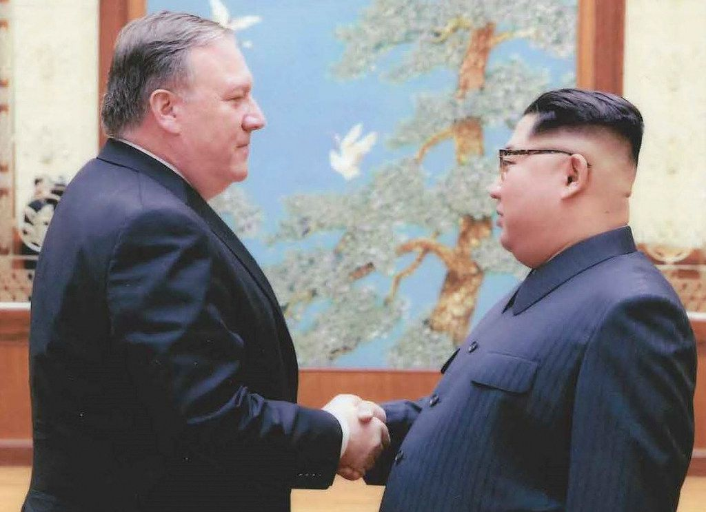 North Korean leader Kim Jong-Un (right) shakes hands with the former CIA Director, now US Secretary of State, Mike Pompeo, in Pyongyang over the 2018 Easter weekend. President Donald Trump announced that Pompeo had been in North Korea to prepare for a landmark nuclear summit.