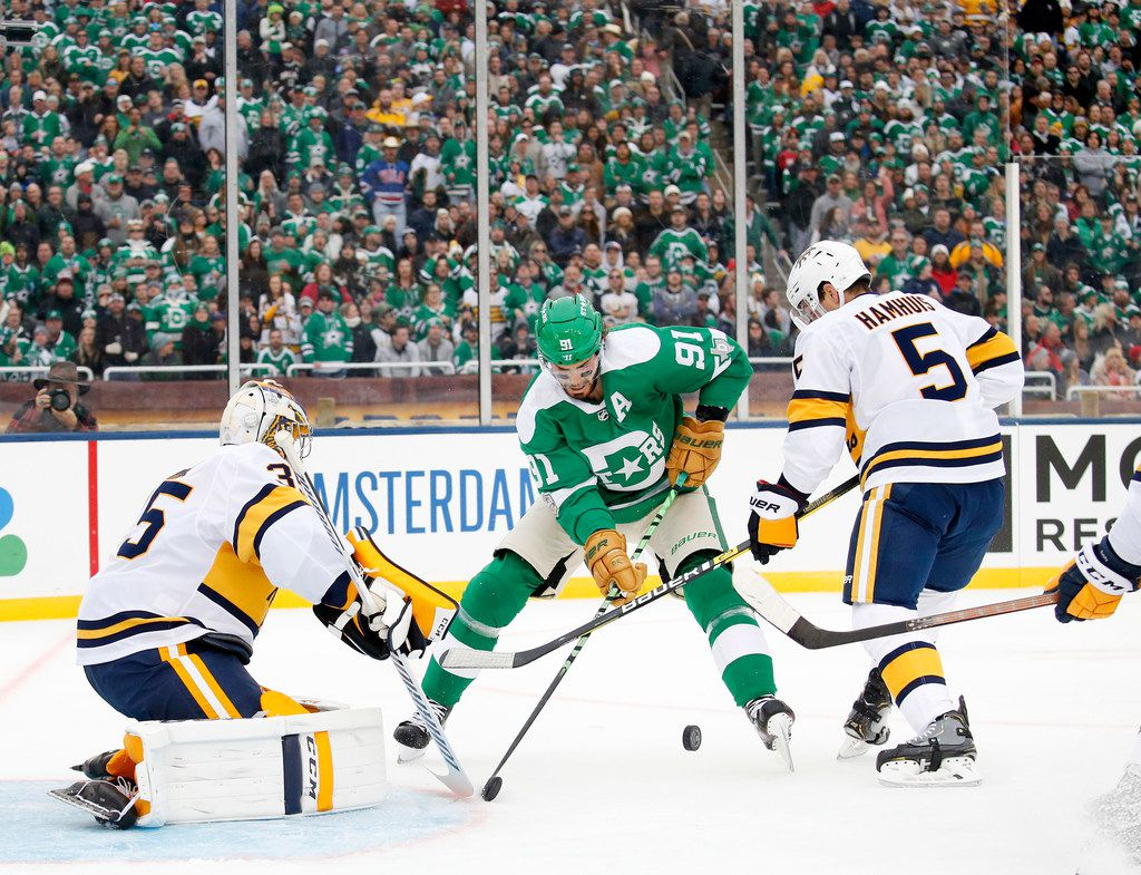 Dallas Stars center Tyler Seguin (91) tries to score on Nashville Predators goaltender Pekka Rinne (35) during the first period of the NHL Winter Classic hockey game at the Cotton Bowl in Dallas, Wednesday, January 1, 2019. (Tom Fox/The Dallas Morning News)