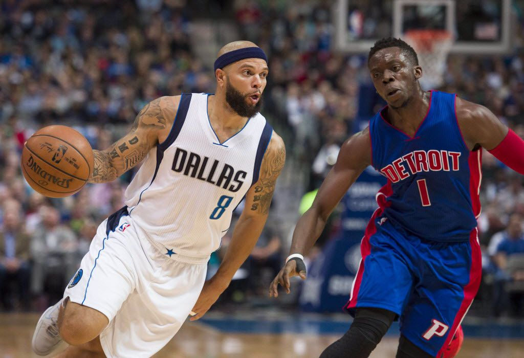 Mar 9, 2016; Dallas, TX, USA; Dallas Mavericks guard Deron Williams (8) drives to the basket past Detroit Pistons guard Reggie Jackson (1) during the first quarter at the American Airlines Center. Mandatory Credit: Jerome Miron-USA TODAY Sports