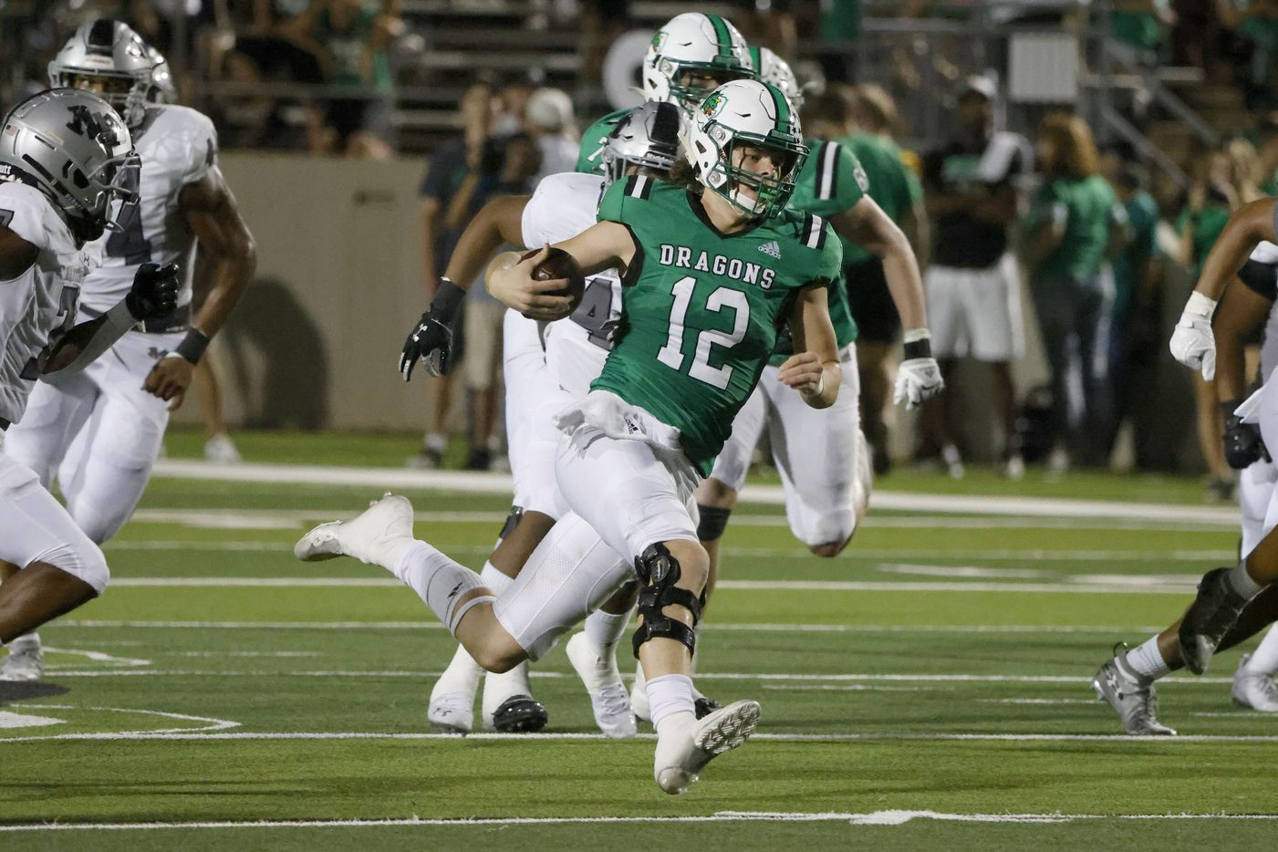 Southlake Carroll quarterback Kaden Anderson (12) scrambles for yards against Arlington Martin during a high school football game in Southlake, Texas on Friday, Sept. 17, 2021. (Michael Ainsworth/Special Contributor)