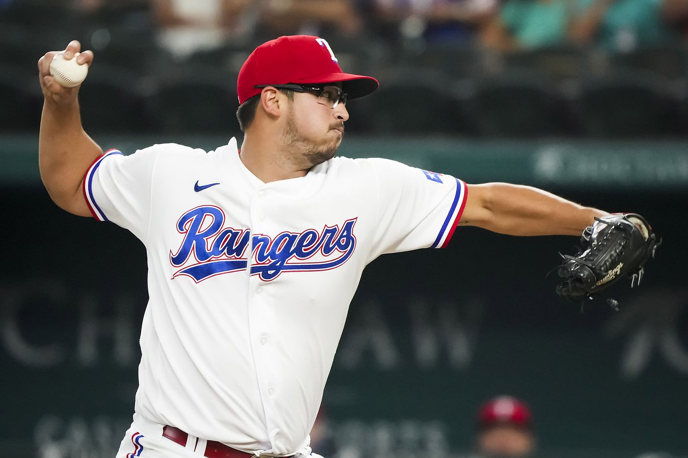 Texas Rangers starting pitcher Dane Dunning delivers during the first inning against the Detroit Tigers at Globe Life Field on Tuesday, July 6, 2021.