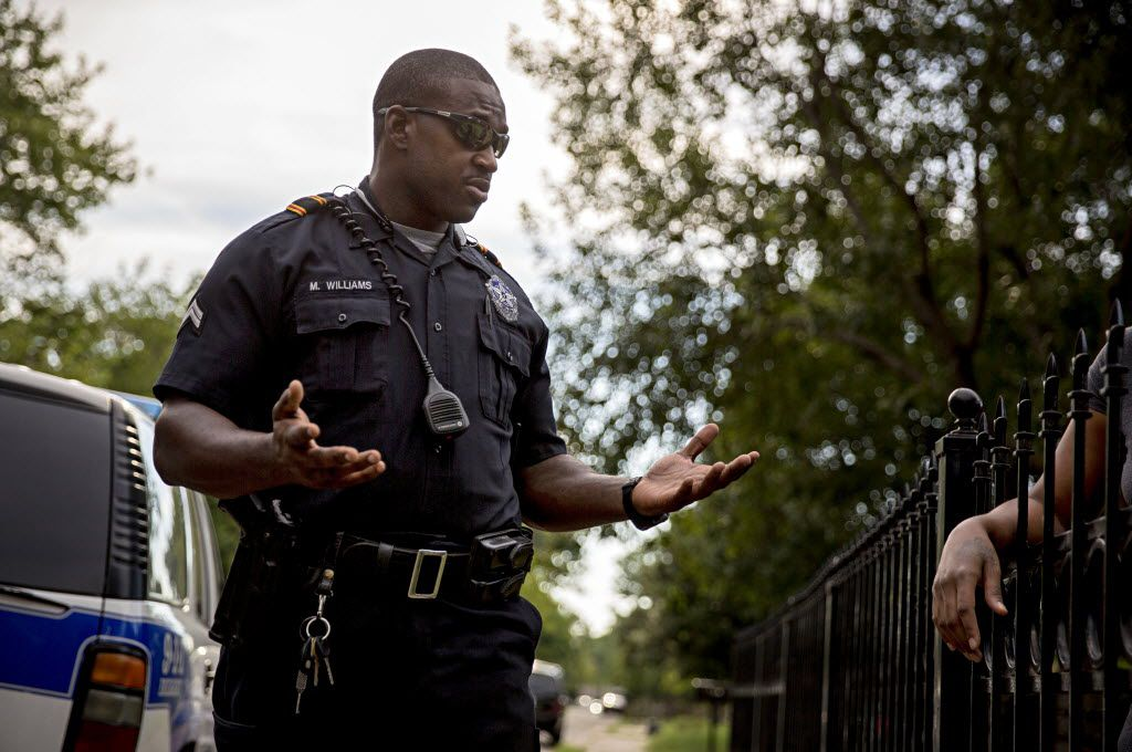 Sr. Cpl. Melvin Williams of the Dallas Police Department talked with a woman after answering a call last year in the Pleasant Grove area of Dallas.