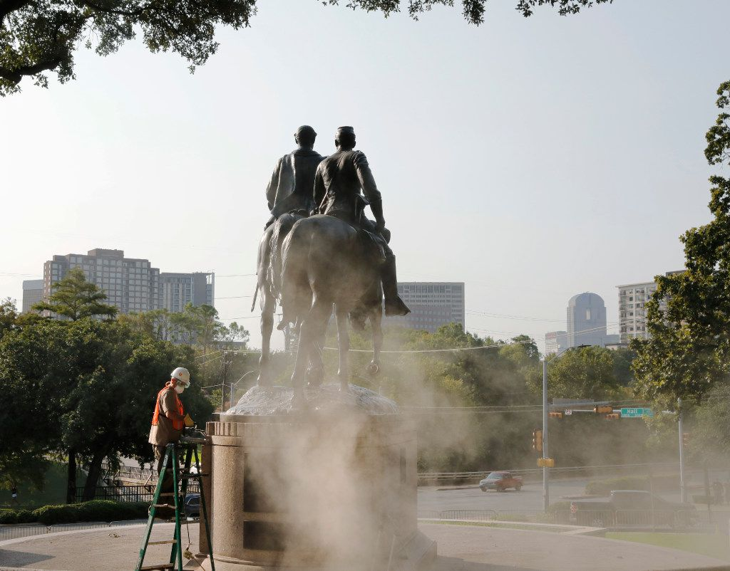 """Michael van Enter works on removing the Robert E. Lee statue at Robert E. Lee Park in Dallas on Friday, Sept. 8, 2017. Michael said it's unlikely the statue will be done Friday because the crew will need the services of a stonemason to ensure the monument is """"perfectly safe,"""" as well as the proper equipment, which is in short supply because of recovery efforts after Hurricane Harvey."""