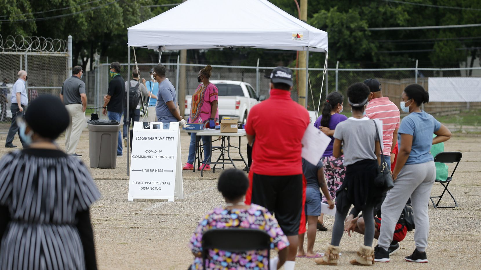 "People wait in line to be tested for coronavirus at a free testing site in Dallas, on Thursday, May 28, 2020. This is the first of five proposed free coronavirus testing sites in Dallas' Southern sector as part of its ""Together we Test"" program. ""Together We Test,"" is a citywide collaboration of ministers, community leaders, health professionals, volunteers and churches with a a goal of eliminating the spread of coronavirus. (Vernon Bryant/The Dallas Morning News)"