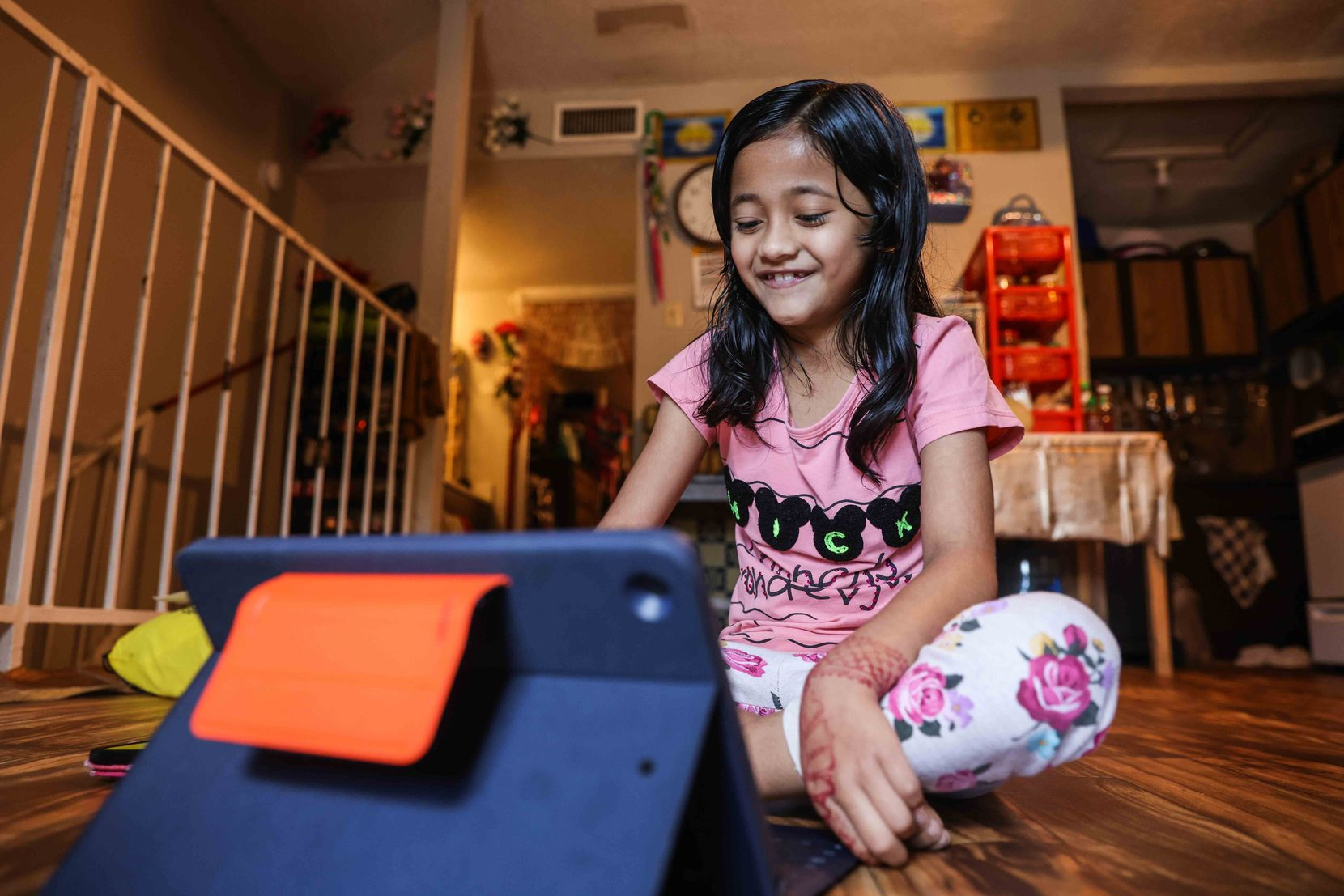 Zakirah Binti Mohammad Yasin, 7, attends a tutoring session by McShan Elementary School from her home via Zoom in Dallas on July 23, 2021. The program helps a largely immigrant student population learn to read in English.