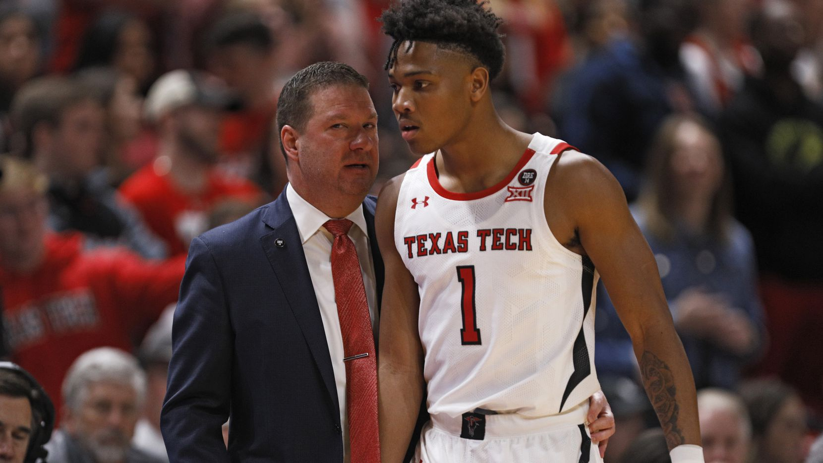 Texas Tech coach Chris Beard, left, talks to Terrence Shannon Jr. (1) during the first half of an NCAA college basketball game against Iowa State, Saturday, Jan. 18, 2020, in Lubbock, Texas. (AP Photo/Brad Tollefson)
