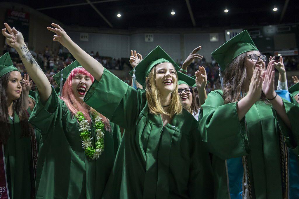 Katelynn Blasavage (center) celebrates with fellow graduates during UNT graduation on Saturday, May 14, 2016, in Denton. (Smiley N. Pool/The Dallas Morning News)