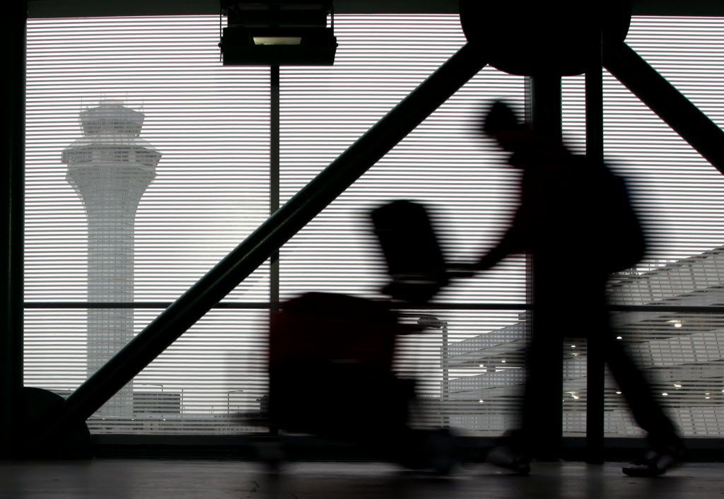 In this Dec. 21, 2013 file photo, a traveler walks through Terminal 3 at O'Hare International Airport in Chicago.