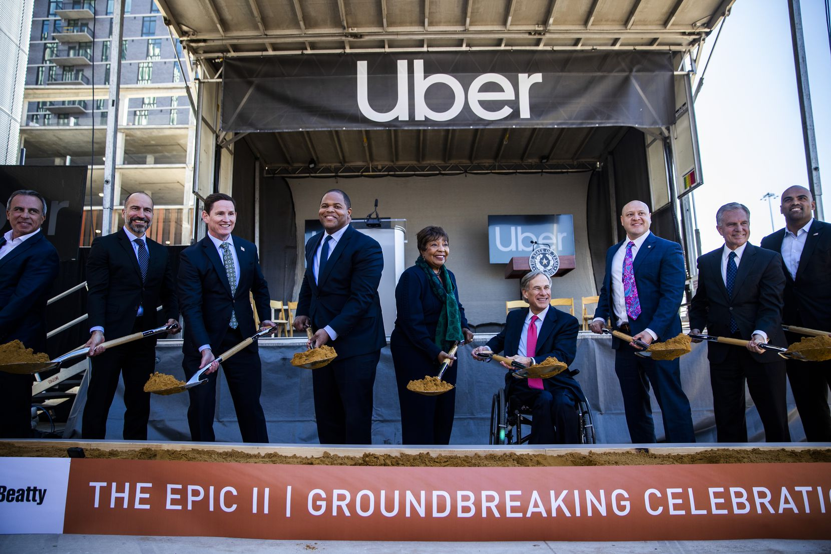 Uber CEO Dara Khosrowshahi (second from left), Dallas Mayor Eric Johnson (fourth from left), Gov. Greg Abbott (fourth from right) and other city and state officials posed for a photo during a groundbreaking ceremony for a new Uber Deep Ellum office in 2019.